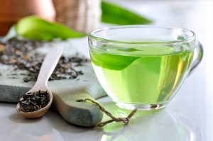 Green spa tea in a glass cup, detox and relaxing warm drink