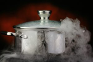 steam over cooking pot on a red background